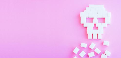 The skull made of sugar cubes. Sugar kills. Pink background