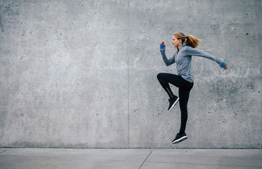 Fit young woman doing cardio interval training