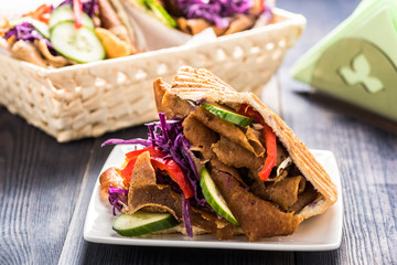 Meat with vegetables in pita bread roll