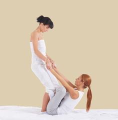 Woman on a Thai massage on a beige background