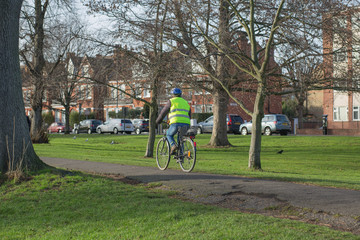 Man riding a bike in the park