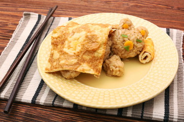 Creative idea for kids snack, breakfast, lunch. Sleeping bear from rice under the blanket of egg omelet. Fun, healthy kids meal. Art of food