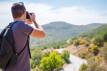 Man taking pictures of mountain