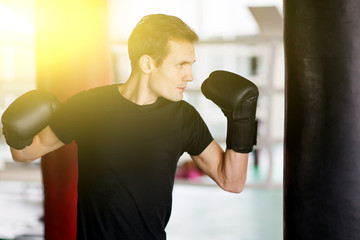 Athlete engaged in boxing gloves