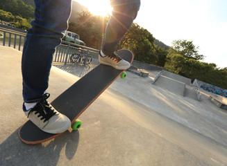 people legs practice skateboarding at skatepark