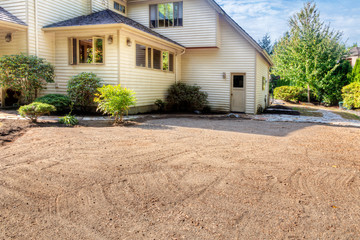Fotobehang - Dirt smoothed and leveled in preparation for laying stone patio