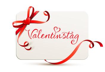 Karte mit roter Schleife, Herz und Schriftzug - Valentinstag