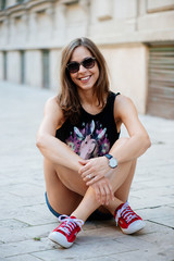 Cute brunette woman in city