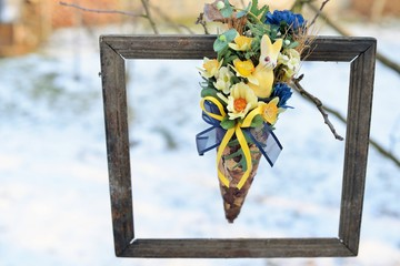3d picture in nature. Dried flowers in a very old photo frame, hanging in a tree