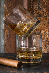 Bourbon whisky stacked glasses with cigar