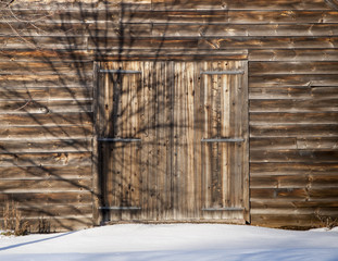 Old Wooden Barn Door in Snow