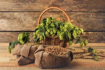 Composition with beer ingredients on wooden background