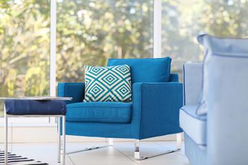 New armchair on window background. Minimalism concept