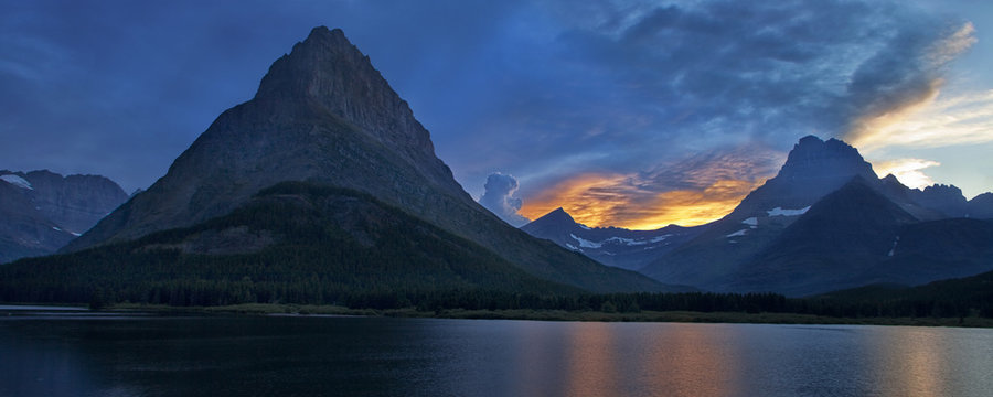 A dramatic sunset is drawing to a close over Mount Grinnell and Swiftcurrent Lake in teh Many Glacier part of Montana's Glacier National Park