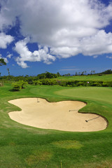 green golf course panorma sand bunker with blue sky in summer