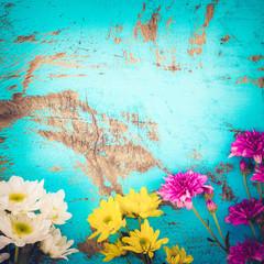 Wall Mural - Colorful flowers bouquet on vintage wooden background, border design. vintage color tone - concept flower of spring or summer background