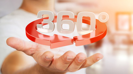 Man holding 360 degree 3D render icon in his han