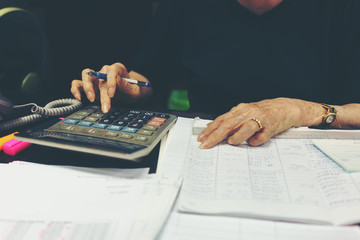 Businesswoman Calculating Financial Data With Calculator