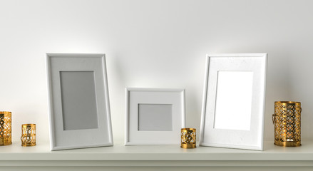 Three blank picture frame with candles on fireplace