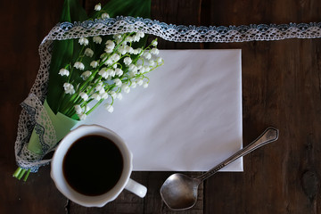 bouquet of lilies of the valley and morning coffee