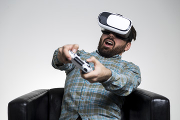 Man in vr glasses impressed by a game