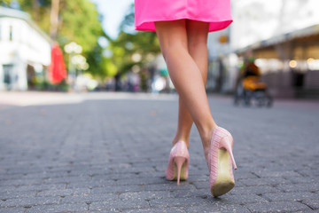 Woman walking down the street in high heels