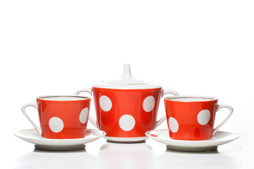 Tea set  with red and  white polka dots design. Cups and sugar bowl.