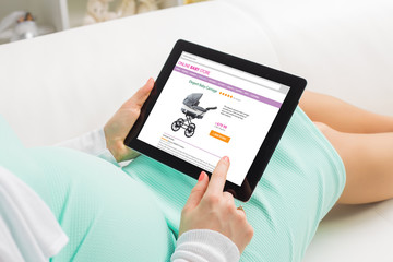 Pregnant woman shopping online on baby store