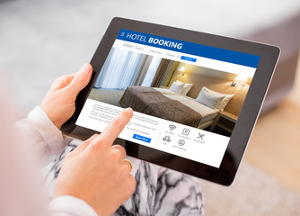 Person booking hotel room on tablet