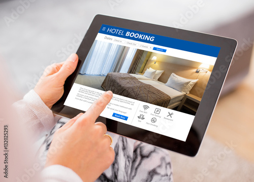 Person booking hotel room on tablet stock photo and for Tablet hotel booking