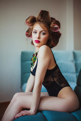 Beauty portrait of young woman wearing curlers