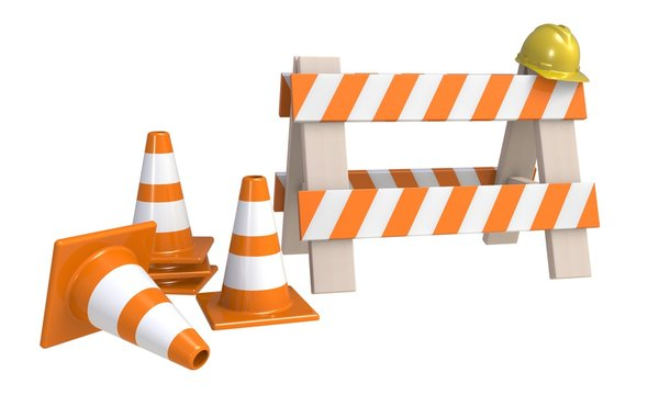 traffic cones and an 'under construction' barrier isolated on a white background. Under construction concept. Road warning sign.