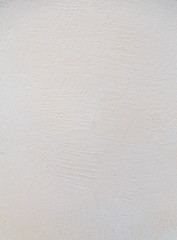 The texture of plaster walls pale yellow rough texture