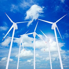 Wind turbines farm against blue cloudy sky 3D illustration