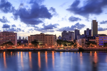 The skyline of the city of Recife in Pernambuco, Brazil at sunset.