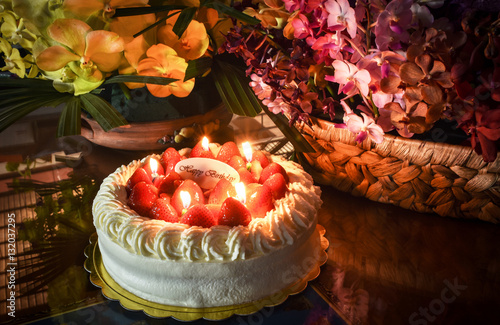 Candles Light On Strawberry Birthday Cake Lighted Up The Atmosphere Of Celebration Surrounded