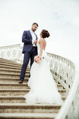 bride and groom standing on stairs together