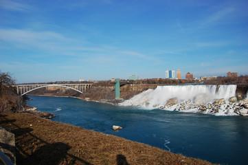 Rainbow Bridge and American Falls of Niagara Falls in winter, New York State, USA.