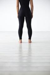 Women's feet in sports leggings. Girl waiting for the start of training