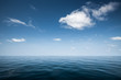 Calm sea with blue clear sky and clouds