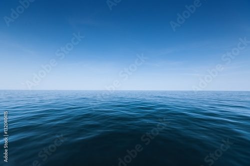 Wall mural Calm sea surface with waves at day
