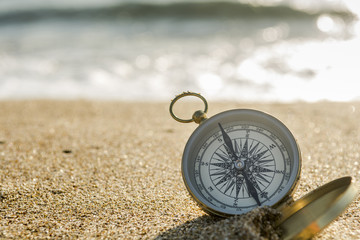 Compass on the beach