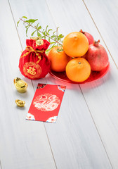 Chinese New year,red envelope packet (ang pow) and red felt fabr