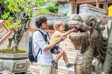 Happy tourists dad and son in LongSon Pagoda