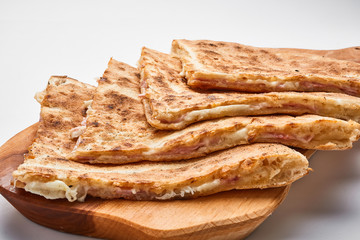 Toasted sandwich with cheese and ham..