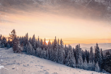 Magic sunset in the snowy mountains. Vintage effect