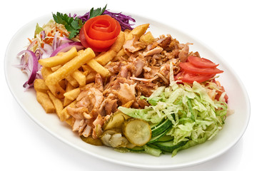 Doner kebab on a plate with french fries and salad