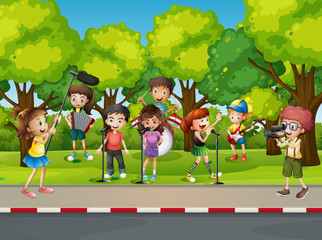 Boy shooting his friends singing in the park