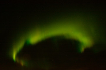 Multi-colored luminescence of the night sky in the northern region.