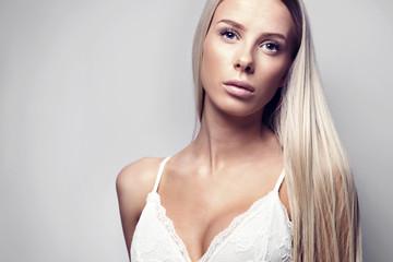 Studio portrait of a blonde woman model in bodysuit